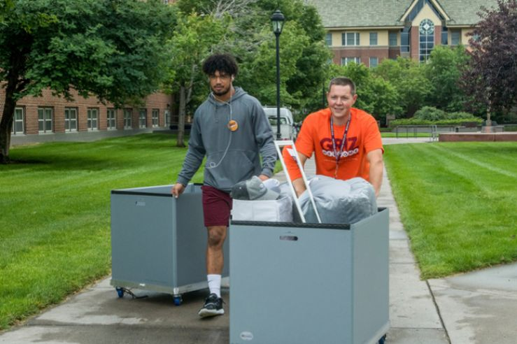 Staff helping students move in to the residence halls.