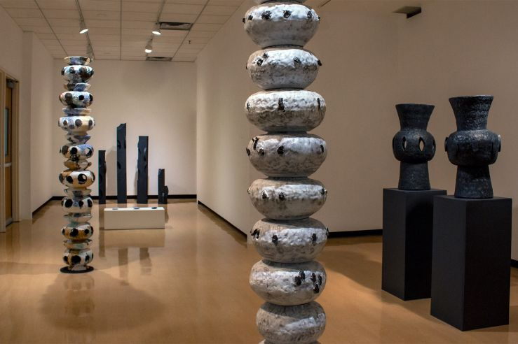 Large, floor-to-ceiling abstract sculptures in the UC Gallery