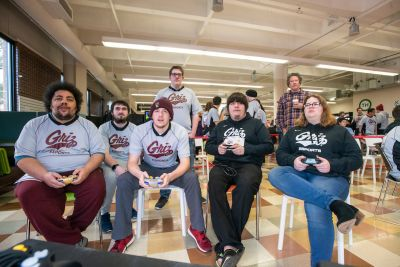 UM students playing video games with Griz shirts on.