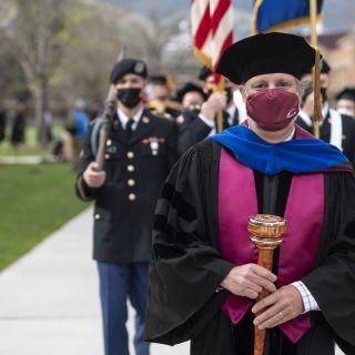 Faculty Senate Chair Chris Palmer with Graduation Mace