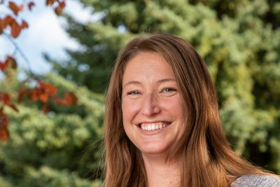 Image of Leah smiling, she's your outdoor adventure admissions counselor