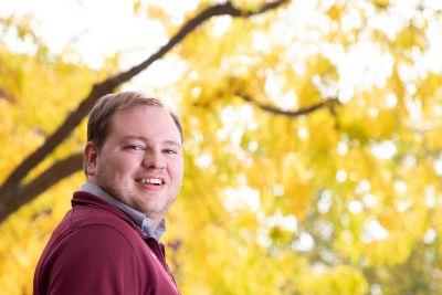 Image of Shaun smiling like a helpful boss