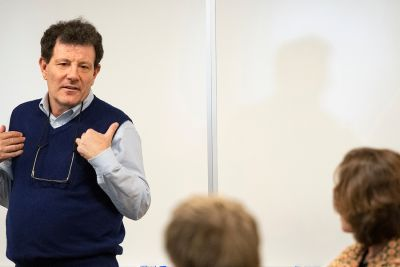 Journalist Nicholas Kristof lectures in the classroom