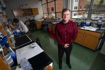 Researcher Jay Evans stands in his UM lab