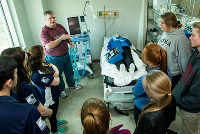 Paul Crockford, respiratory care director at Missoula College, teaches health students in ventilator use.