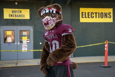 Monte the mascot stands outside a Missoula polling place.