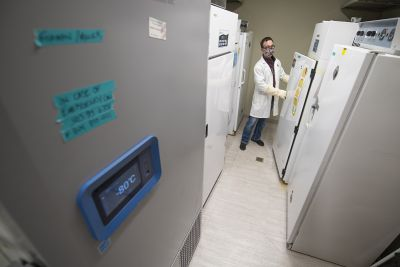 Kenneth Chatriand, pharmacist pharmacy manager, opens a subzero freezer.