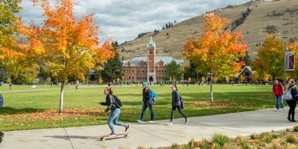 Students make their way around the Oval at UM in the fall.